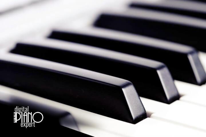 piano keys with logo