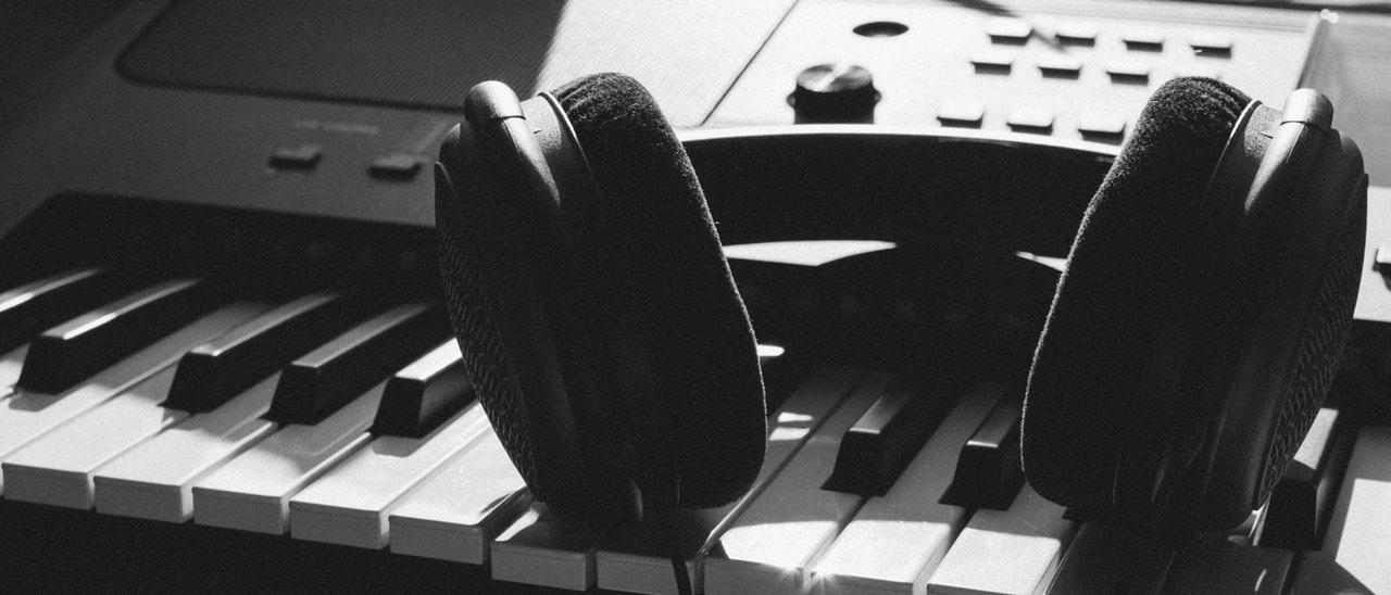 Keyboard and headphone in black and white photo